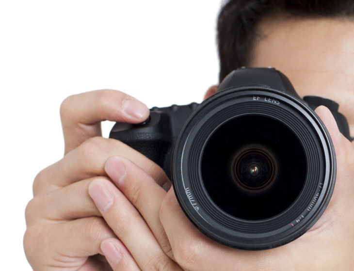 Young man taking photos